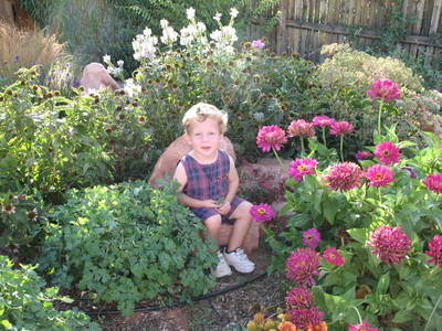 Sean_in_front_flower_bed